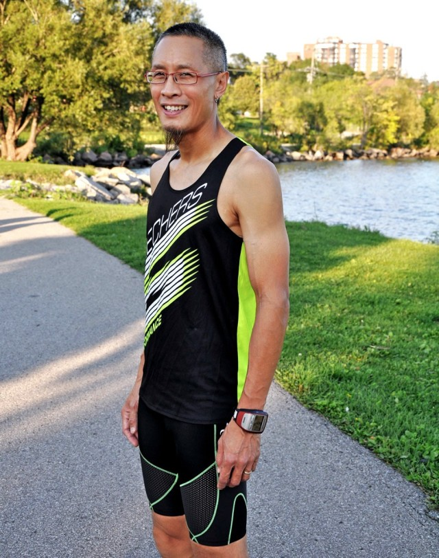 man in running outfit on a running path downtown barrie