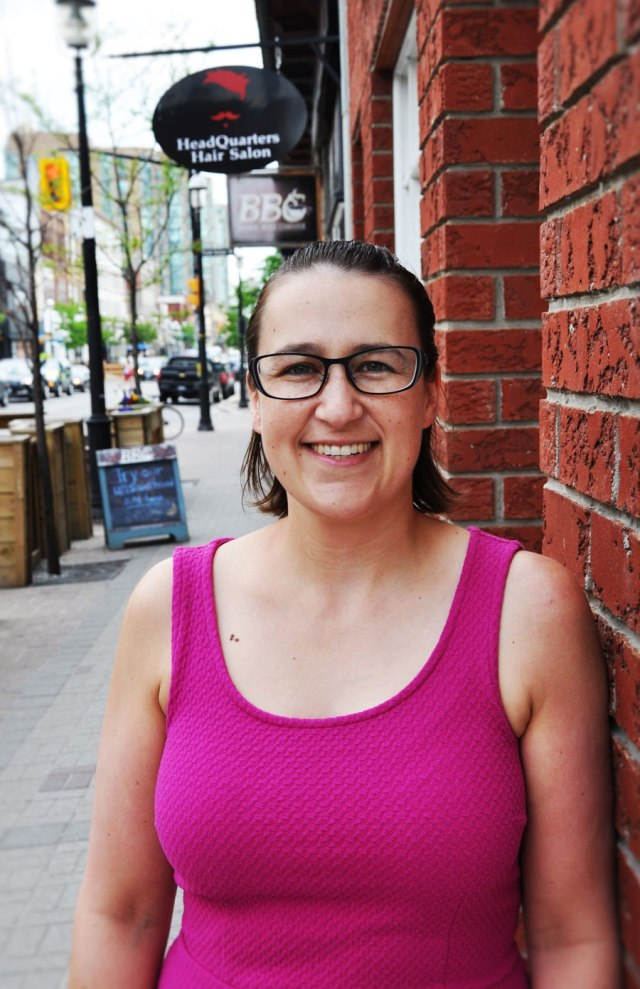 Woman in pink tank top downtown Barrie, glasses