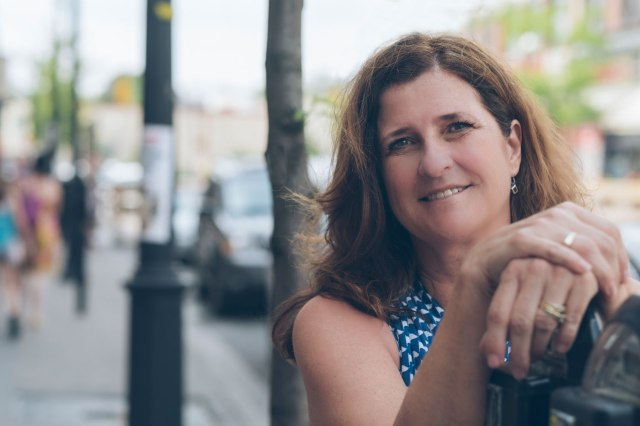 woman leaning on metre downtown Barrie