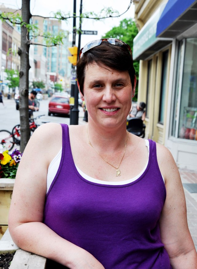 woman in purple tank top downtown Barrie, short dark hair