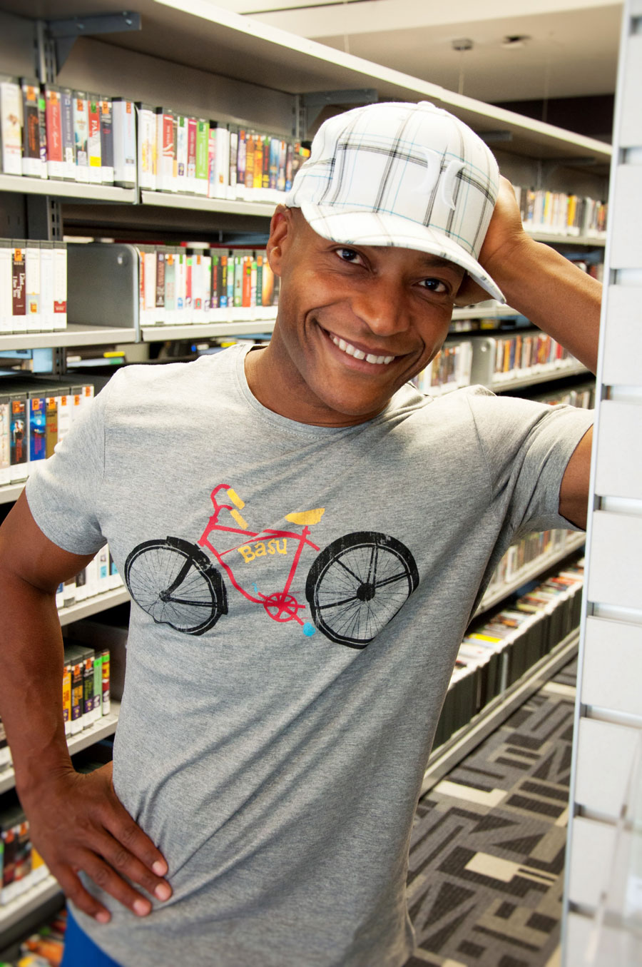 man with hat and sports outfit on in library