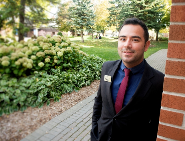 young international student in a suit at college campus