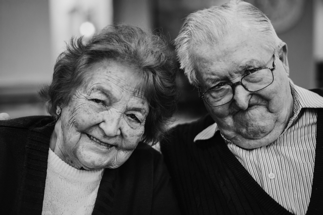 Elderly couple; black and white head shot