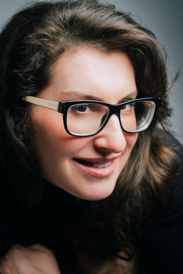 young woman, close up, wearing black glasses, long dark hair